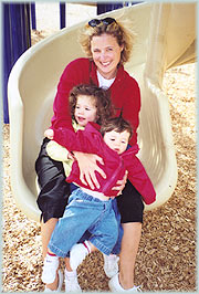 Mom and kids on playground slide